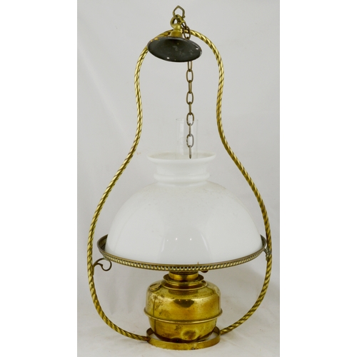 60 - HANGING OIL LIGHT FITTING. 25ins tall. Period brass framed with milk glass shade. Very good. (9/10)...