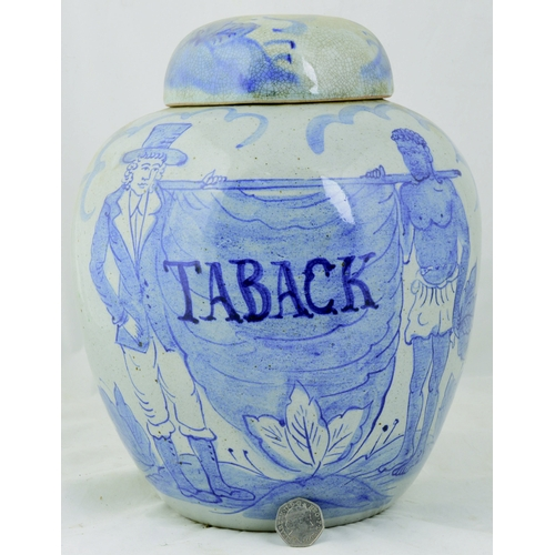 62 - TABACK JAR. 11ins tall to top of lid. Giant shop counter type jar, blue & white hand painted with im...