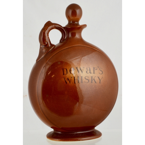 78 - KINGSWARE PEACE WHISKY FLAGON FLASK. 7.5ins tall, brown body (1929), dolphin shape handle. Multi-col...