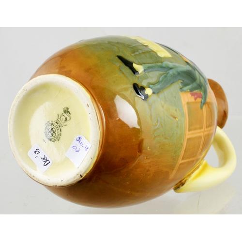 80 - QUEENSWARE STIGGINS FLASK. 8.6ins tall, overall warm cream body colour. Stiggins with tray to front ...