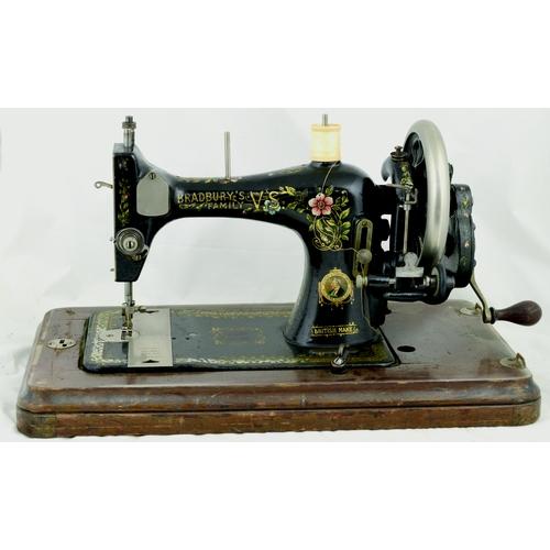 103 - BRADBURY'S FAMILY V.S. SEWING MACHINE. 10.5ins tall. Cast machine, wood base, gold & pink decoration...