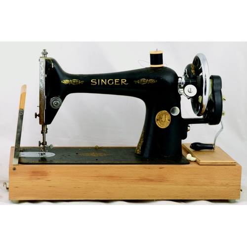 105 - SINGER SEWING MACHINE. 13ins tall. Cast machine on wood base, gold decoration, hand cranked, c. 1938...