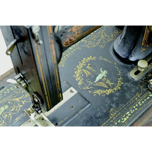 106 - THE ROYAL LEADER SEWING MACHINE. 10.5ins tall. Cast machine, wood base & original wooden cover/ lid,...