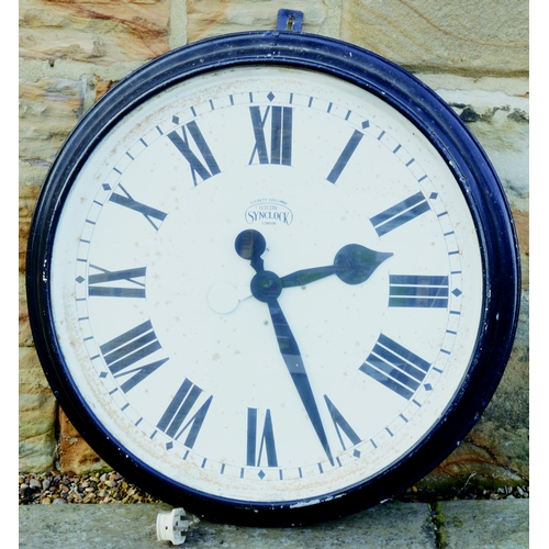 129 - LARGE CLOCK. 28ins diam. Electric clock made by Synclock London. Some overall wear. (7/10)...