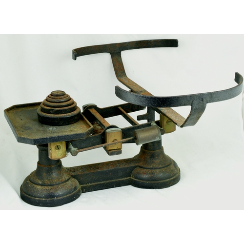 136 - SHOP SCALES. Heavy cast scales (no basket) inc. weights. Needs a little TLC. (6/10)...