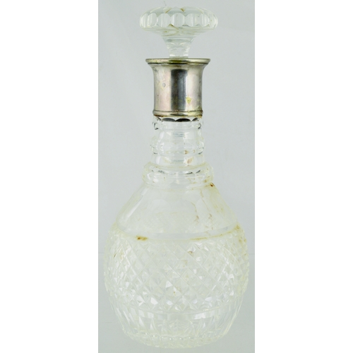 157 - CUT GLASS CARAFE. 10.75ins tall. Clear glass with possible silver collar (rubbed). (8/10)...