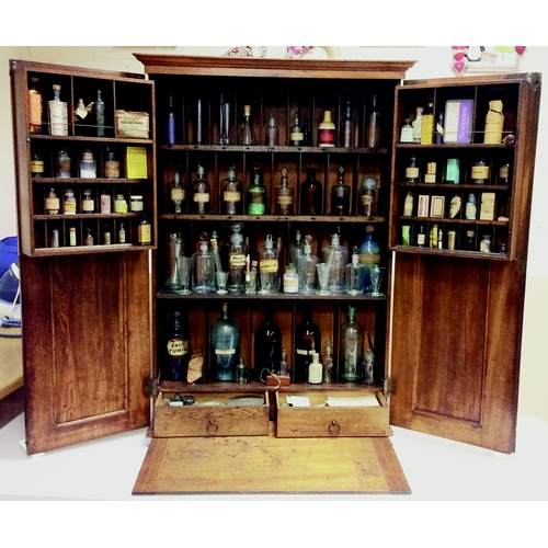 176 - PHARMACY CABINET. 47 by 31 by 11ins when closed.Oak cabinet, lots of compartments, 2 pull out drawer...