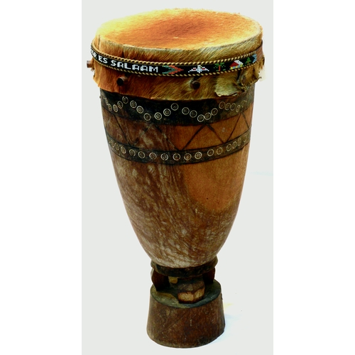 178 - TANZANIAN DRUM. 21ins tall. Wood & hide. Dar Es Salaam  on beaded band around top....
