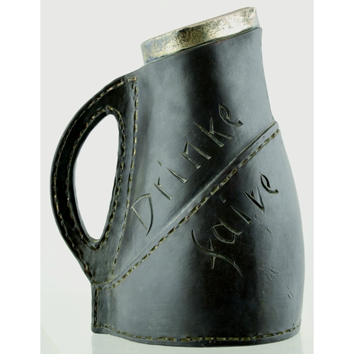 207 - DOULTON LAMBETH SILICON WARE BLACK JACK JUG. 9ins tall.  Simulated leather, hallmarked silver rim. '...