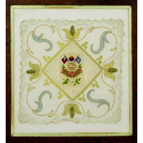 230 - SOUTH WALES FRAMED EMBROIDERY. 15.5 by 14.5ins. WW1 framed embroidery for the South Wales Border Reg...