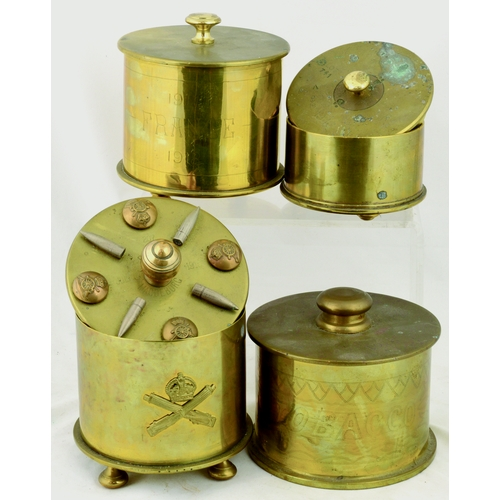240 - TRENCH ART GROUP. Tallest 4.5ins. Lidded tobacco jars casing pots, one ornate with bullets & button ...