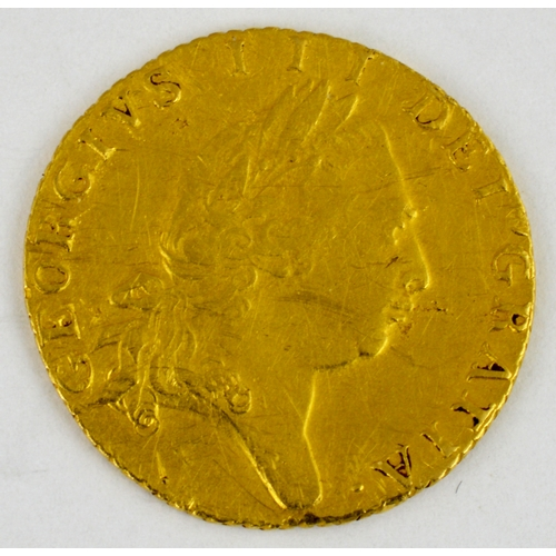 252 - GOLD HALF GUINEA. George III, dated 1797. 4.2g weight, well worn....