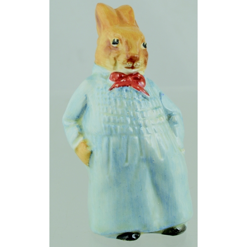 269 - EARLY ROYAL DOULTON 'REGGIE BUNNYKIN' FIGURE. 4ins tall. Model D6025, wearing blue smock and red bow...