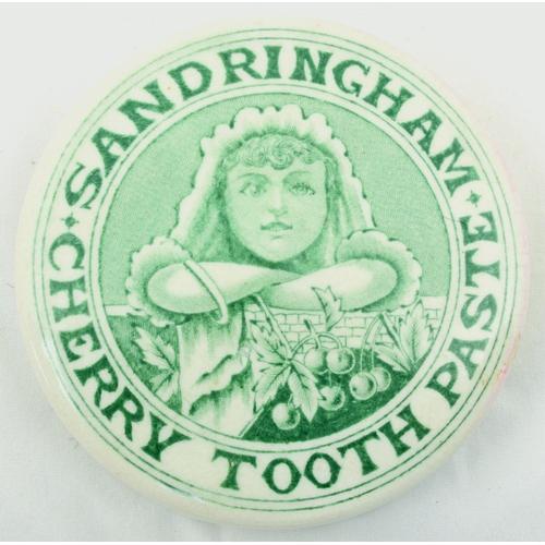 517 - SANDRINGHAM CHERRY TOOTHPASTE POT LID. (APL p 351, 60) 3ins diam. Green transfer SANDRINGHAM/ CHERRY...