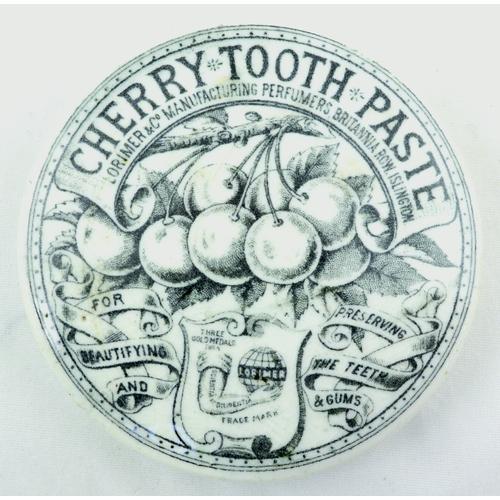 522 - LORIMER & CO CHERRY TOOTH PASTE POT LID. (APL p 340, 47) 2.5ins diam. Black transfer for CHERRY TOOT...