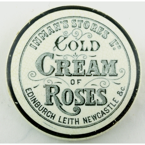 528 - EDINBURGH COLD CREAM POT LID. (APL p 540, 51) 2.75ins diam. Black transfer for INMAN'S STORES LTD/ C...