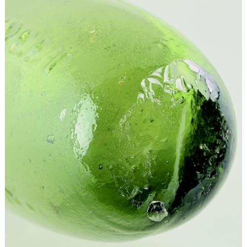 557 - DE. GRUCHY SODA WATER HAMILTON. 7.5ins long. Variating green glass, unusual flat, pontilled, bottom,...