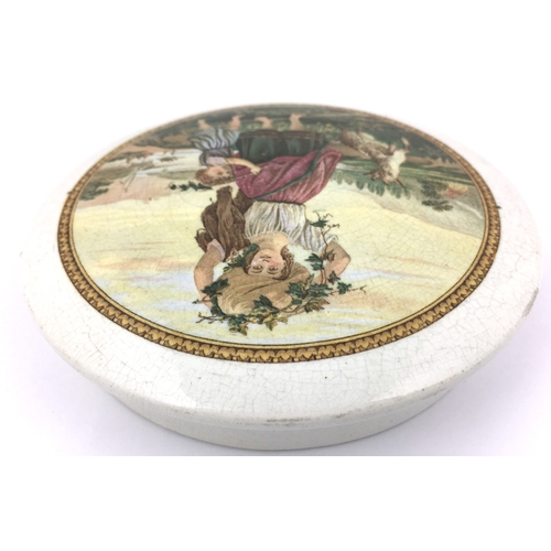 17 - THE VINE GIRL POT LID. (KM 333) 4.75ins diam. Multicoloured image, this being the later variant with...