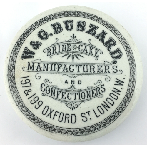 18 - LONDON BRIDE CAKE POT LID. (APL p 269, 168) 4ins diam. A very large size, flat topped pot lid, black...