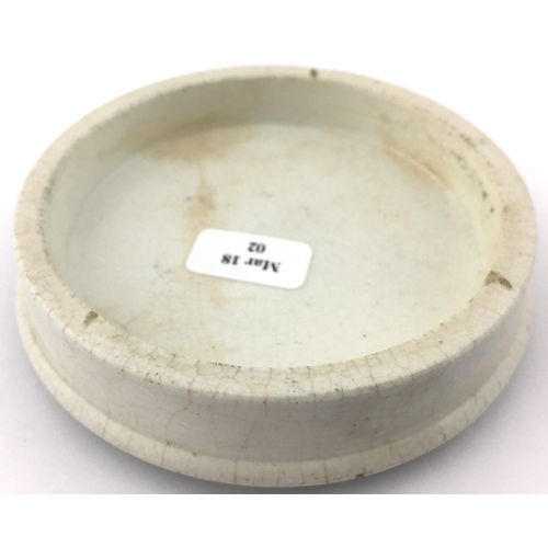 20 - MANCHESTER TOILET CREAM POT LID. (APL p 433, 123) 3ins diam. Black transfer FOR THE GROWTH AND RESTO...