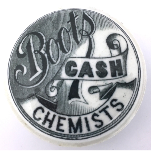9 - BOOTS CASH CHEMISTS POT LID. (APL p 469, 5a) 1.75ins diam. White button lid with a really strong, as...