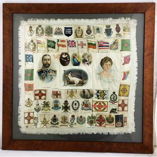 29 - ANTIQUE MILITARY SILKS FRAMED PATCHWORK. Approx. 2ft square frame. King George V (BDF cigarettes) & ...