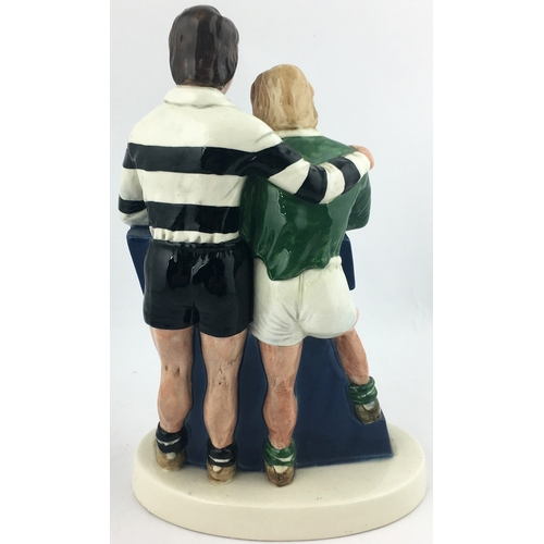 34 - WORTHINGTON E BESWICK FIGURE GROUP. 9.1ins tall. Mlticoloured couple of rugby players enjoying a wel...