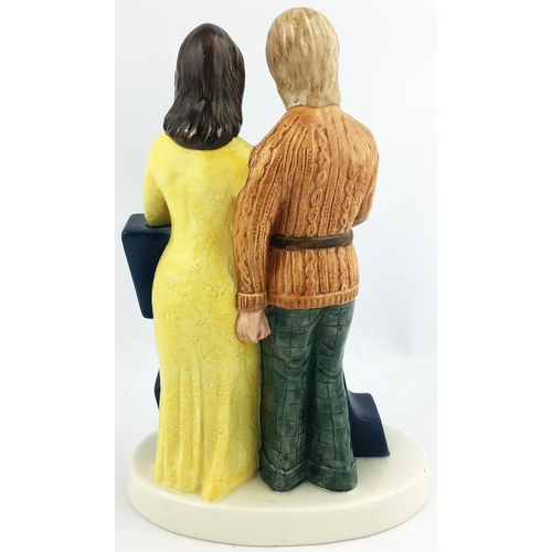35 - WORTHINGTON E BESWICK FIGURE GROUP. 9.1ins tall. Mlticoloured couple both enjoying a pint - dressed ...