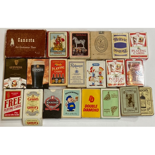 38 - ADVERTISING PACKS OF DRINKS RELATED PLAYING CARDS. A very good spread from whisky, Guinness, Gin, Be...