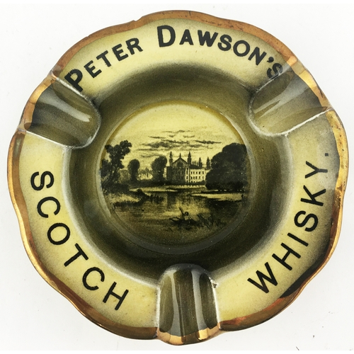 40 - PETER DAWSONS SCOTCH WHISKY ASHTRAY. 4.6ins diam. Central building, pond with boat on etc to centre....