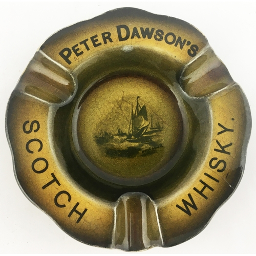 42 - PETER DAWSONS SCOTCH WHISKY ASHTRAY. 4.3ins diam. Central sailing boat image, serrated rim with 3 ci...