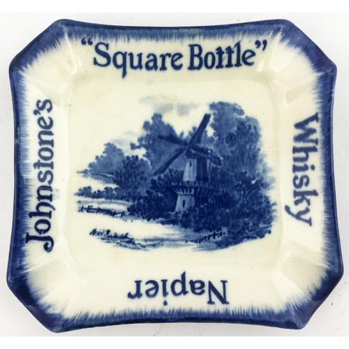43 - JOHNSTONES SQUARE BOTTLE WHISKY NAPIER ASHTRAY. Approx. 5ins square. Blue & white  transfers & edgin...