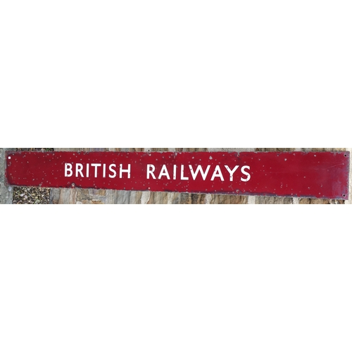 49 - BRITISH RAILWAYS ENAMEL SIGN. 50 x 6ins. White lettering on maroon background. Pit marks visible - a...