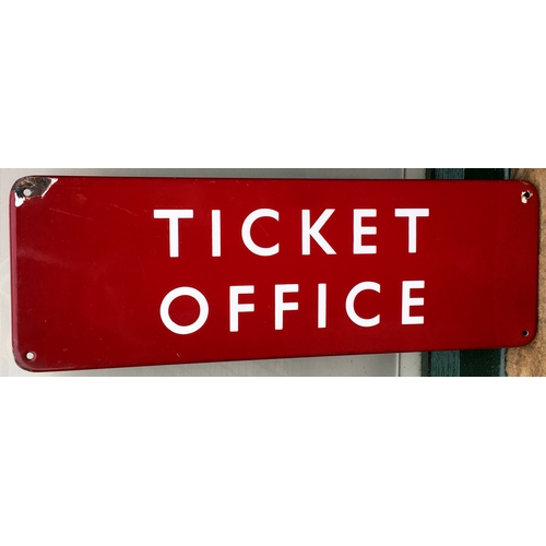 51 - RAILWAY TICKET OFFICE ENAMEL SIGN. 18 x 6ins.  White lettering on maroon. Couple of screw hole area ...