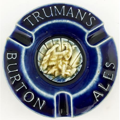57 - RUMANS BURTON ALES ASHTRAY. 4.6ins diam. Doulton Lambeth dark blue stoneware glazed item with eagle ...