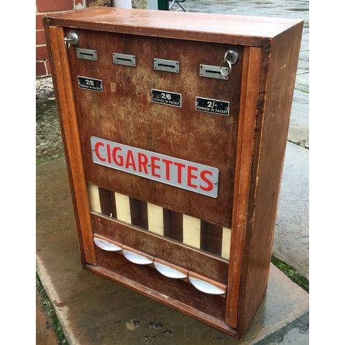 9 - CIGARETTE VENDING MACHINE. 25.5 x 18 x 6.5ins. Wooden case with various metal attachments, vending s...
