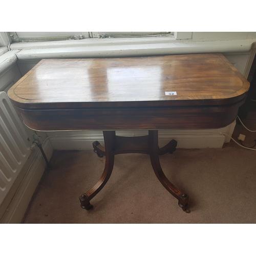 a regency mahogany foldover card table with baized interior brass