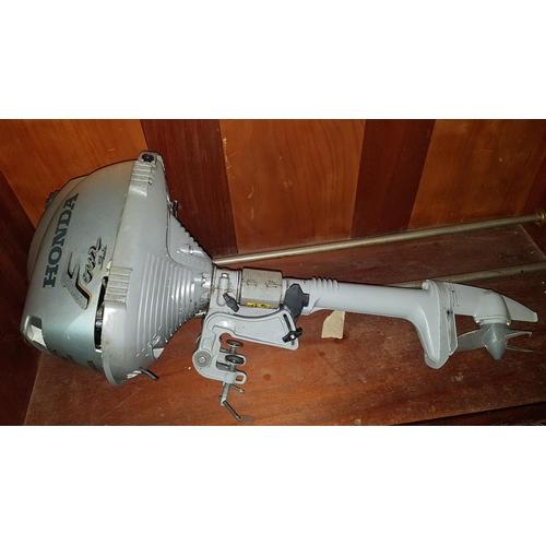 46 - A Honda four stroke Outboard Motor....