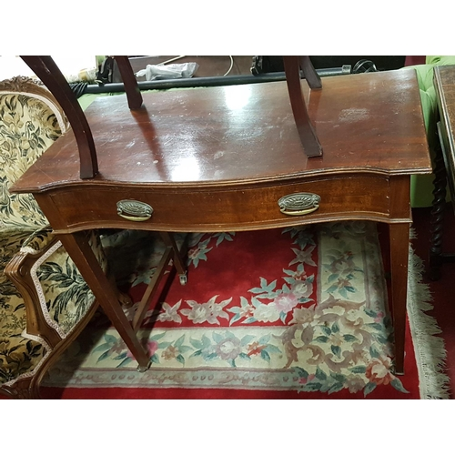 18 - An Early 20th Century Mahogany concave Side Table. W91cm X D47cm....