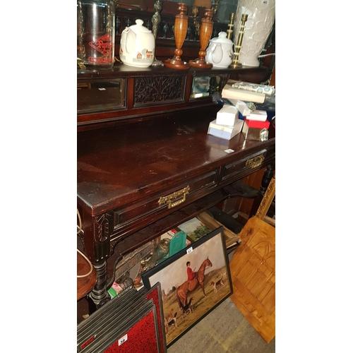 40 - A 19th Century Walnut gallery backed Side Table. W137cm X D55cm....