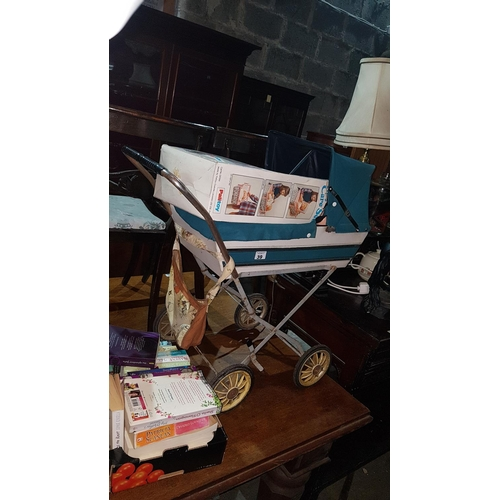 39 - A Vintage Dolls Pram and Doll, a vintage Tiny Tears care set, and a box of Books...