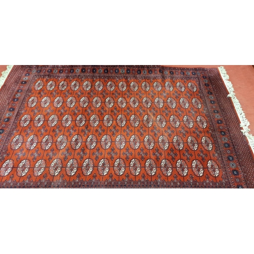 27 - A large burgundy Rug with all over decoration and multi borders in very good condition. 310 x 200 cm...
