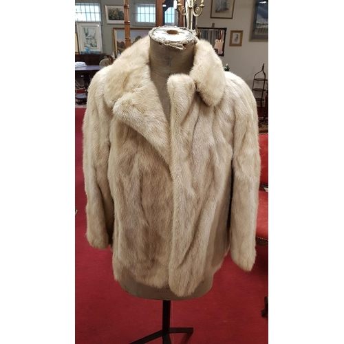 36c - A vintage Ladies cream Fur Coat from Barnardo's...
