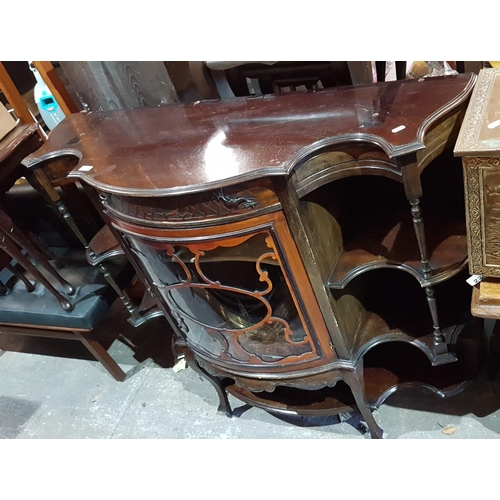 21 - An Edwardian Mahogany Cabinet with a mirrored back....
