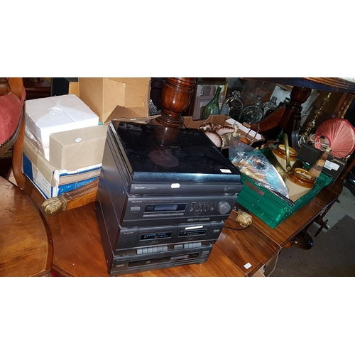 33 - A Sharp Stereo System and Speakers along with a large quantity of items in various boxes including t...