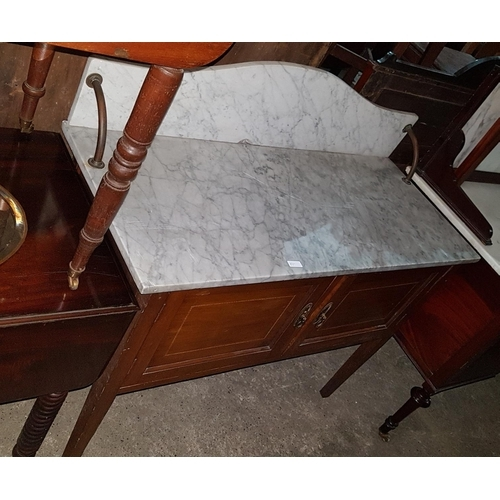 55 - An Edwardian Mahogany Washstand with a marble top....