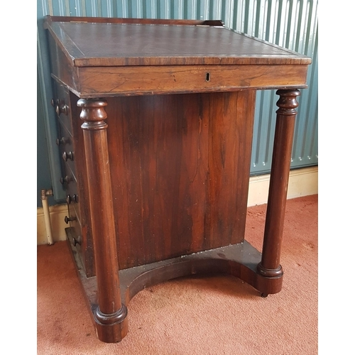 6 - A really good 19th Century Rosewood Davenport with fitted top drawer and interior and with turned fr...