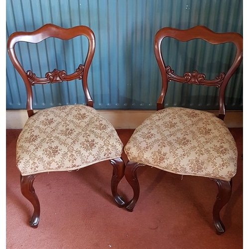 43 - A good set of six Victorian Mahogany Buckleback Chairs with upholstered seats....