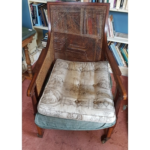 55 - An Edwardian Mahogany Inlaid Armchair with cane work detail....