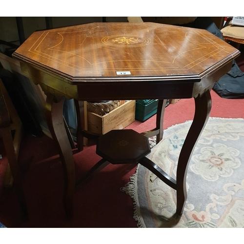12 - An Edwardian Mahogany Inlaid Centre Table....